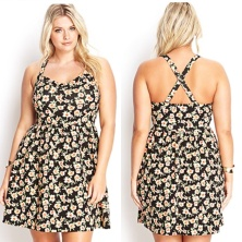 Black dress with light florals and a cris-crossed back.