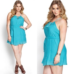 Bright colored, loose fitting dress. Cami-strapped. Jersey-style.